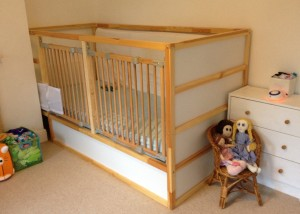 View of our original hack of an Ikea Kura bed with wooden stair gates infilling the open side