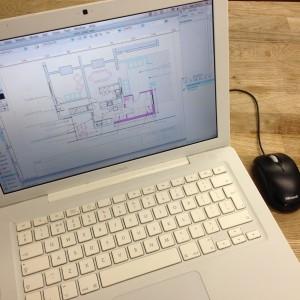 Laptop showing house plan