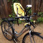 Bike with yellow toddler bike seat
