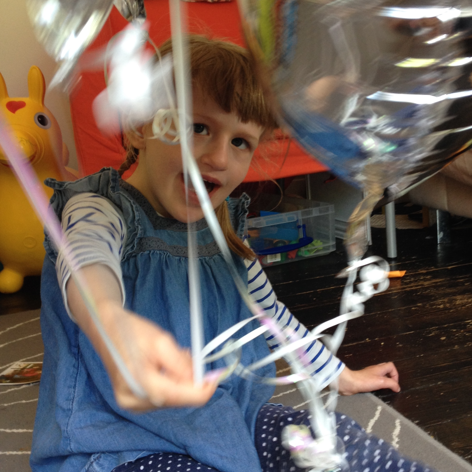 EJ playing with some foil balloons