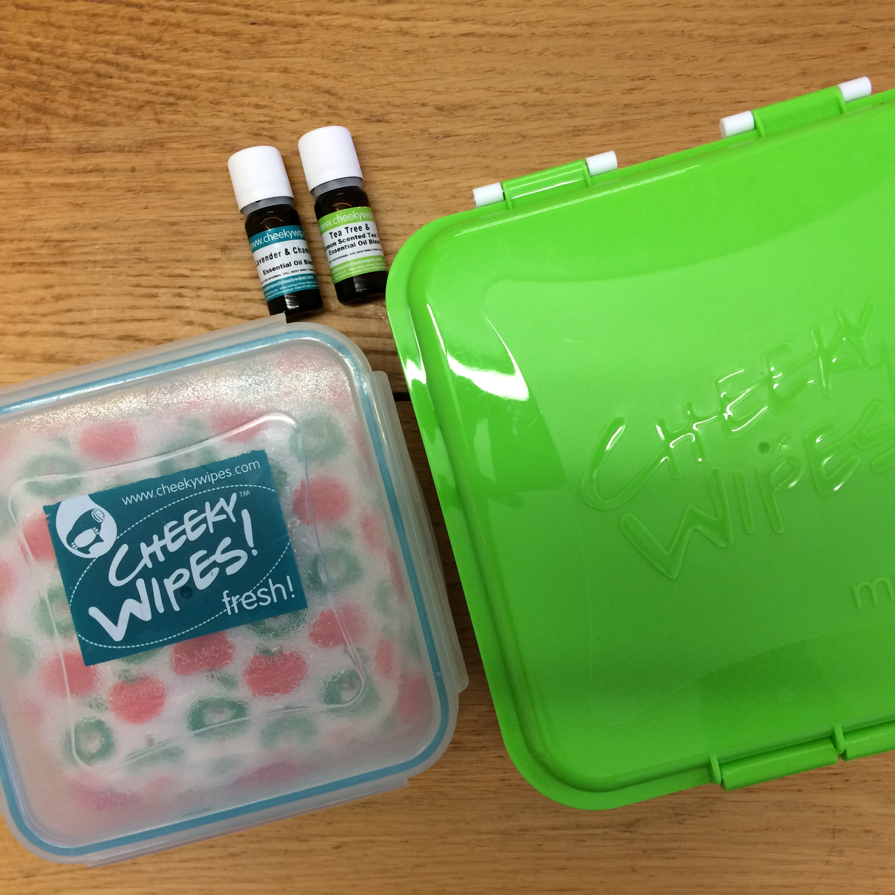 Photo of cheeky wipes clean and mucky boxes and essential oils