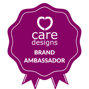 Magenta coloured rosette shaped graphic with white text in the centre: Care Designs Brand Ambassador